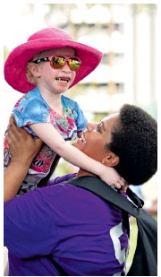 ?? Photo: Ronald Kumar ?? Ema Marie 26, with her four-year-old daughter Mereoni Faith of Nadi during International Albinism Awareness Day at Ratu Sukuna Park in Suva on June 13, 2018.