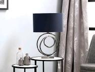 ??  ?? BHS Saturn swirl base table lamp with dark grey shade, £ 60 ( 0333 005 0070; bhs. com)