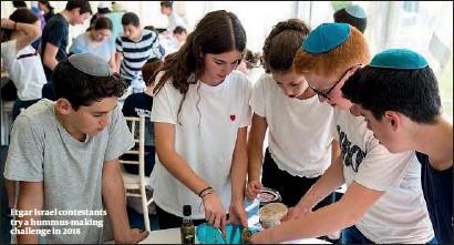 ?? PHOTO: CHRIS MORGAN ?? Etgar Israel contestants try a hummus-making challenge in 2018