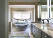 ?? JOHN COLE ?? ABOVE: Free-standing tubs are not just a trend, Wilder says. He views them as pieces of art, and says they provide a more spacious, transitional design. LEFT: During the pandemic, Wilder's firm has received many requests for kitchen renovations.
