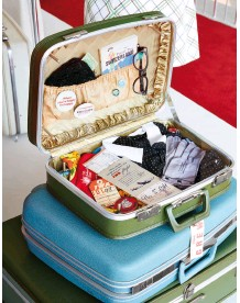 ?? ©David Mitchell ?? Traveling in style: a vintage suitcase packed with retro TWA ephemera is exhibited at the TWA hotel.