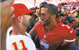 ?? Scott Strazzante / The Chronicle 2014 ?? Former quarterback teammates Alex Smith, then of the Chiefs, and Colin Kaepernick of the 49ers, seen at a 2014 game, should team up one more time.