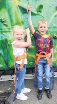 ??  ?? New heights climbing wall Ava Ross and her brother Theo enjoy the