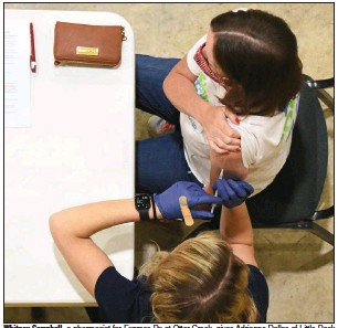 ?? (Arkansas Democrat-Gazette/Staci Vandagriff) ?? Whitney Campbell, a pharmacist for Express Rx at Otter Creek, gives Adrienne Dallas of Little Rock her second dose of the Pfizer vaccine Thursday at Henderson United Methodist Church in Little Rock. More photos at arkansasonline.com/416vaccine/.