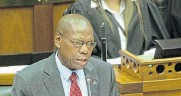 ?? Picture: RODGER BOSCH/AFP ?? SITUATION UPDATE: Health minister Zweli Mkhize addresses parliament on the virus