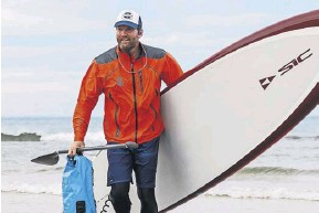 ?? PHOTOGRAPH: WILL REDDAWAY/WR ?? ▲ Prince with his board Scarlet during his circumnavigation of Britain to raise funds for a water safety app for schools