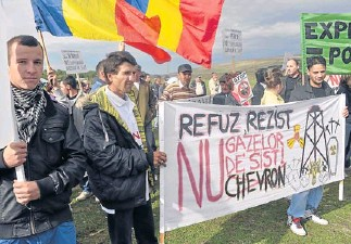 ?? AFP ?? Protesters hold a banner that reads 'I refuse, I resist to shale gas, No to Chevron'' during a protest against the exploitation of shale gas in the village of Gagesti (300 kilometres northeast from Bucharest), Romania on September 15.