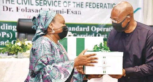 ??  ?? Folasade Yemi-Esan (left), Head of the Civil Service of the Federation, and Aigboje Aig-Imoukhuede, chairman, Africa Initiative for Governance (AIG), during the handover of Standard Operating Procedures, globally recognised manuals that apply step-by-step instructions, which were compiled by the AIG, for the Office of the Head of Civil Service of the Federation (OHCSF), recently