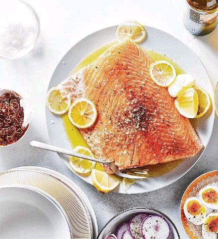 ??  ?? Salt-and-pepper salmon served with tangy cucumbers, fried shallots, hardboiled eggs and more. Such assemble-it-yourself meals can help one get more out of cooking for friends by flipping the time spent working to time spent eating.