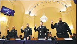 ?? Chip Somodevilla Associated Press ?? OFFICERS from the U.S. Capitol Police and the Washington, D.C., Metropolitan Police Department appear before the House select committee.