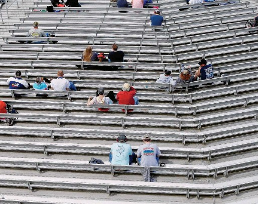 ??  ?? Race fans were allowed inside Richmond Raceway for the NASCAR races with COVID-19 safety protocols in Virginia allowing for 30% capacity and fan groups remaining six feet apart.