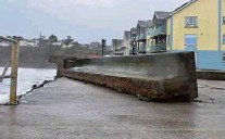 ?? Picture: Tina Schley ?? A section of the storm wall on the prom at Tramore was broken in pieces.