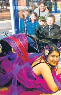 ?? Picture: Steve MacDougall. ?? Shayna McLean, posing as a mermaid, watched by some of the children who attended her storytelling session and Anne Marie MacLellan, from the Cancer Research UK shop.