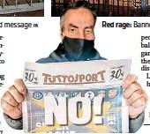 ?? GETTY ?? Euro-pain: Fan reads coverage in an Italian sports paper