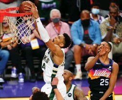 ?? (Reuters) ?? AFTER FALLING behind 2-0 in the NBA Finals, Giannis Antetokounmpo (dunking) and the Milwaukee Bucks have stormed back to win the next three games over the Phoenix Suns and now are on the brink of capturing the championship.