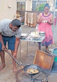 ?? Supplied ?? DAREN Naidoo, left, and Vino Daya Kisten, demonstrate how to make vada. They will be at the market day. |