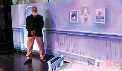 """?? The Sentinel-Record/Tanner Newton ?? ■ Edmond Cooper, artistic director and president of Hot Springs Children's Dance Theatre Company, stands on the stage at LakePointe City Church. The theater company will hold two performances of """"Peter Pan"""" this week."""