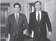 ?? SEAN KILPATRICK / THE CANADIAN PRESS ?? Finance Minister Bill Morneau said the PBO's report reinforces the idea that spending will help the economy.