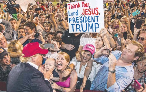 ??  ?? TRUMP'S TROOPS: Donald Trump greets supporters after a rally in Mobile County, Alabama last week. Picture: Getty Images