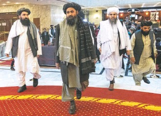 """?? ALEXANDER ZEMLIANICHENKO/POOL/REUTERS ?? Abdul Ghani Baradar, center, the deputy prime minister in the Taliban's interim government, is seen in Moscow in March. On Wednesday, Baradar said top Taliban leaders """"have good and cordial relations."""""""