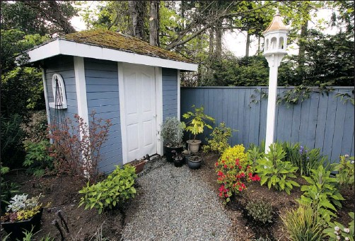 ?? DARREN STONE/Postmedia News ?? A shed can add practical outdoor storage space and increase the value of your property – if it's built right.