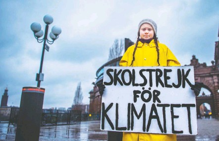 """?? HANNA FRANZEN/TT NEWS AGENCY/REUTERS ?? Greta Thunberg, 15, first attracted media attention earlier this year when she went on strike from school to protest inaction on climate change, holding a sign outside the Swedish parliament building in Stockholm that reads, """"School strike for climate."""""""