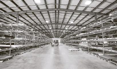 ?? Steve Gonzales / Staff photographer ?? A&C Plastics resumed an expansion project after demand for plastic sheets skyrocketed with market demand for pandemic-related safety products such as face shields.