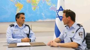 ?? (Marc Israel Sellem/The Jerusalem Post) ?? CMDR. Eliaz Haliva, head of the Israel Police International Cooperation Unit, with Supt. Micky Rosenfeld.
