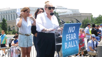 ?? (Ron Kampeas) ?? MEGHAN MCCAIN speaks at Sunday's rally against antisemitism, as Israeli actress Noa Tishby and Arizona State Rep. Alma Hernandez look on at the US Capitol in Washington.