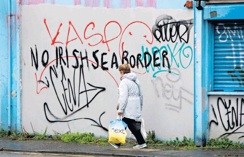 ??  ?? The writing is on the wall: the Protocol has destabilised the delicate balance in Ulster, toppling two Unionist leaders and bringing mass protests to the streets