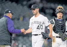 ?? David Zalubowski, The Associated Press ?? Rockies manager Bud Black, left, takes the ball from relief pitcher Tyler Kinley as he is pulled from the game during the sixth inning on Tuesday night at Coors Field.