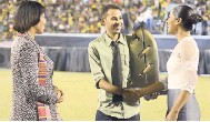 ??  ?? Fab 5 band was recognised by the JCDC for their outstanding contribution to music. Prime Minister Portia Simpson Miller (left), and Minister of Youth and Culture Lisa Hanna (right), presented the award to Andrew Campbell, son of band member Frankie...