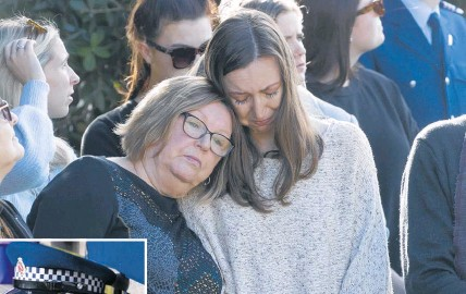 ?? Photo / Brett Phibbs ?? Diane Hunt and daughter Eleanor console each other as friends and family remember their son and brother, Matt Hunt.
