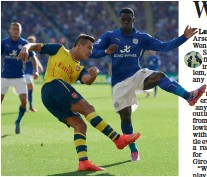 ?? — AFP ?? Arsenal's Alexis Sanchez ( left) in action against Leicester City's Jeff Schlupp during their EPL match in Leicester on Sunday. The match ended 1- 1.