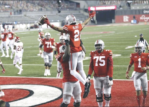 ?? Tribune News Service ?? Ohio State wide receiver Chris Olave (2) celebrates a 33-yard touchdown catch during the fourth quarter of a game against Rutgers at Ohio Stadium on Nov. 7, 2020, in Columbus, Ohio.