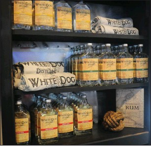 ?? Ernest A. Brown photo ?? On display and available for purchase at White Dog will be their own corn whiskey, gin, white rum, and candy apple moonshine. The name of the business, 'White Dog,' is slang for moonshine.