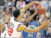 ?? 2011, TIMES-DISPATCH ?? University of Richmond teammates Justin Harper (32) and Darrius Garrett pressured Morehead State's Kenneth Faried during the 2011 NCAA tournament meeting of the programs in Denver.