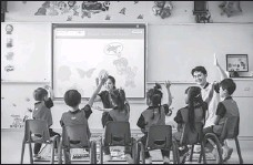 ?? PROVIDED TO CHINA DAILY ?? Children take offline classes offered by Rise Education Cayman Ltd, a Nasdaq-listed education company, in Beijing.