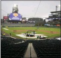 ?? ASSOCIATED PRESS ?? Players take part in batting practice as a light rain descends on Coors Field on Tuesday before the Colorado Rockies host the Arizona Diamondbacks in a baseball game in Denver. Major League Baseball announced that Coors Field will be the venue for the 2021 All-Star Game after the Midsummer Classic was moved out of Atlanta because of sweeping changes to voting rights established in the state of Georgia.