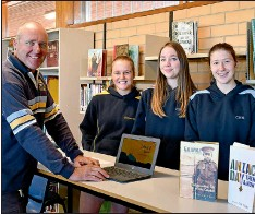 ??  ?? Mr Andrew Pickering with students Clancy Tomlinson, Tia Pickering and Megan Shipard. The students dedicated six weeks of research to their historical biographies creating detailed accounts of the experiences of local soldiers in the First World War.