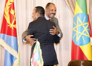 ?? Reuters ?? Ethiopia's Prime Minister Abiy Ahmed and Eritrean President Isaias Afwerk embrace at the declaration signing in Asmara, Eritrea, on Tuesday. —