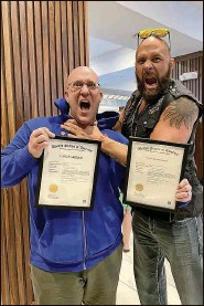 """?? Courtesy of Michael Dockins ?? The """"Gimmick Attorney"""" Michael Dockins and wrestler client Lance Archer show off Archer's trademarks."""