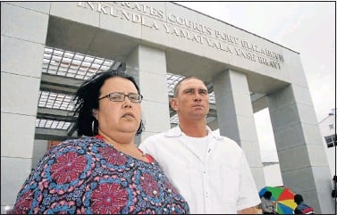 ?? Picture: EUGENE COETZEE ?? BEREAVED MOTHER: Michelle le Roux and Riaan de Beer outside the Port Elizabeth Regional Court where they are attending the trial of Carl Nasson who allegedly shot dead Le Roux's daughter, Victoria