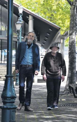 ?? PHOTO: GREGOR RICHARDSON ?? Poets treading . . . Poet, writer and publisher Roger Hickin (left) and Dunedin poet and photographer Peter Olds walk Dunedin streets yesterday.