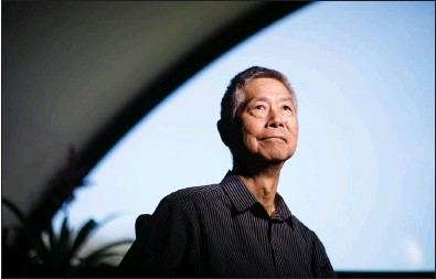 """?? DAI SUGANO — STAFF PHOTOGRAPHER ?? Gordon H. Chang, professor and the author of """"Ghosts of Gold Mountain,"""" stands in his office at Stanford University on Thursday."""