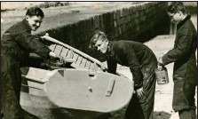 ??  ?? Prince Philip, centre, doing boat maintenance at Hopeman Harbour