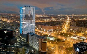 ?? AP ?? An image of Russian President Vladimir Putin, speaking during his annual state of the nation address, is shown on an electronic screen, installed on the facade of a tower in St Petersburg.