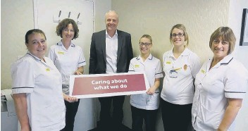 ??  ?? Chief executive Patrick Crowley with physiotherapists at Scarborough Hospital. Submitted.