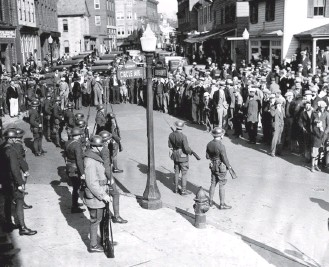 """?? ASSOCIATED PRESS ?? Troopers keep a crowd in check in Salisbury in 1933. They were sent by Gov. Albert Ritchie to arrest suspects in the lynching of George Armwood in Princess Anne. In 1931, Matthew Williams, who was accused of murdering Daniel Elliott, was lynched in Salisbury. Almost 90 years later, descendants of Williams and Elliott were brought together by the """"Silent No More"""" memorial event in Salisbury."""