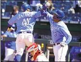 ?? Orlin Wagner Associated Press ?? THE ROYALS' Carlos Santana celebrates his two-run home run with Salvador Pérez.